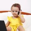 Little girl using modern communication tools
