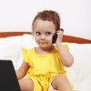 Little girl using modern communication tools